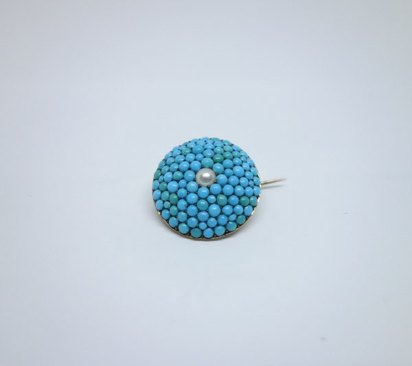 broche or et turquoises