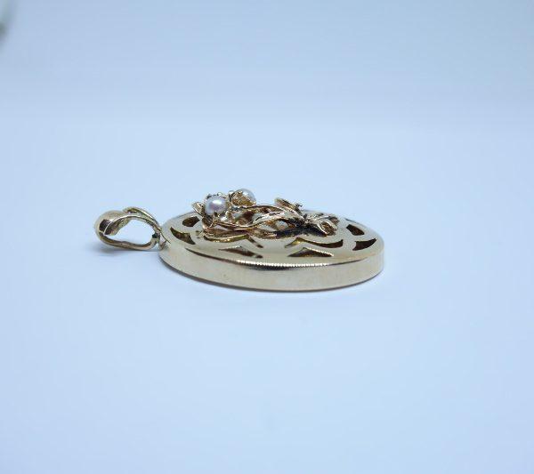 pendentif or ajouré perles fines