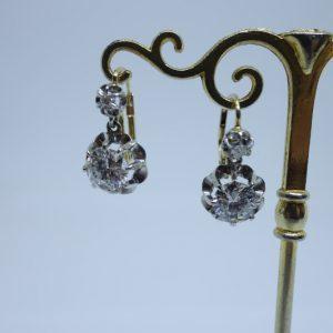 boucles d'oreilles or et gros diamants