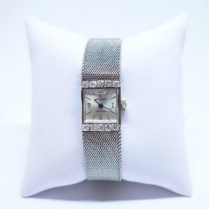 montre femme or gris et diamants signé Jack Sandoz