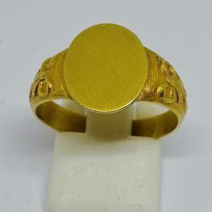 chevalière en or avec motif de ruban travail art nouveau