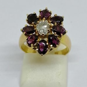 bague en or avec grenats facettés et diamant taille ancienne vers 1880