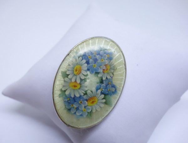 broche argent décor floral