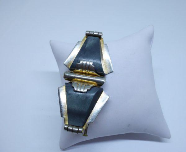 broche métal bicolore et bakélite