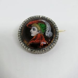 Broche ronde or/argent