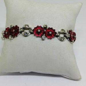 bracelet métal blanc et pâte de verre rouge et pierres blanches art déco 1930