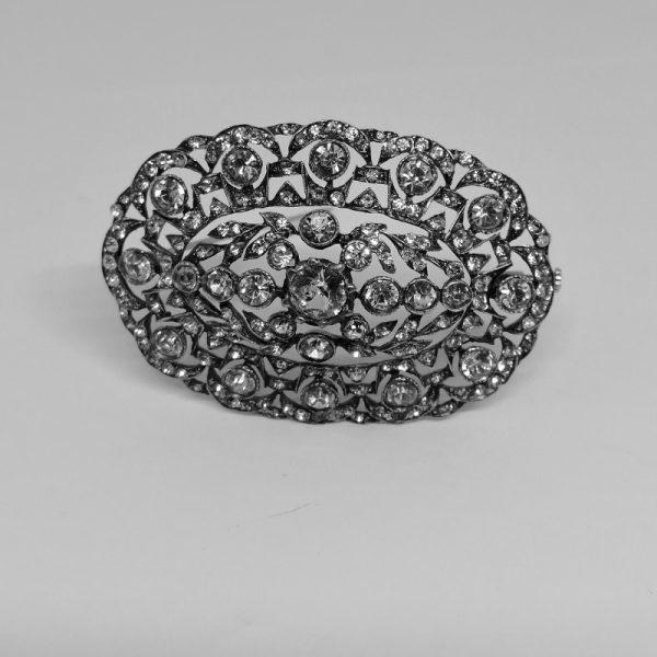 Broche argent ajourée pavé de cristal taillé époque 1900