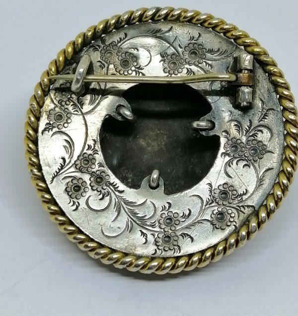 broche argent et vermeil avec tête d'enfant et sertie de grenats facettés vers 1870
