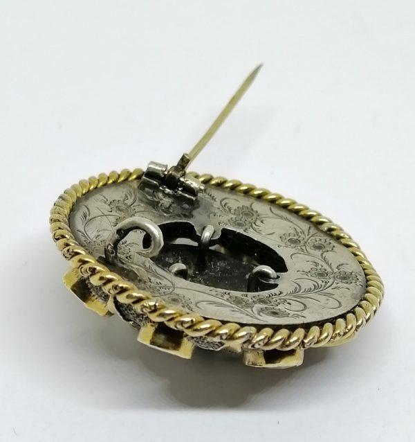 broche en argent et vermeil avec tête d'enfant et sertie de grenats facettés vers 1870