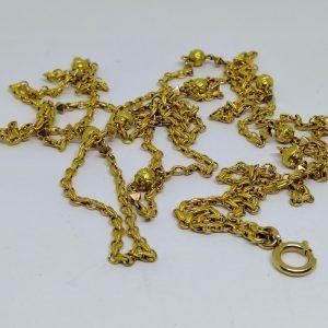 long sautoir en or tricolore avec maillons particuliers vers 1890