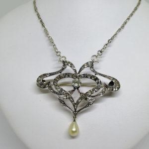 broche/collier argent avec pavage de pierres blanche et en pampille une perle d'imitation en goutte, époque 1880-1900.